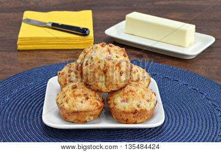 Homemade bacon cheddar biscuits, close up front view.