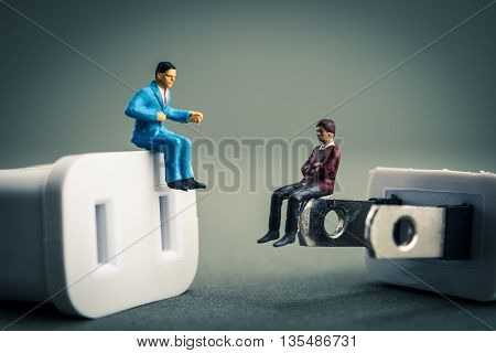electrical outlet cord and miniature doll businessman