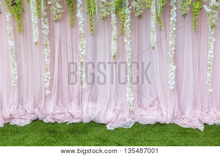 Flower backdropthe backdrop in the wedding ceremony with the grass and flower.The beautiful flower backdrop for ceremony of wedding.