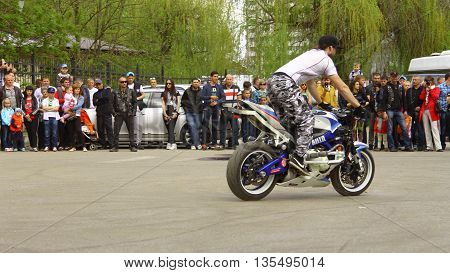 May 1, 2015: Moto free style pilot stunting on the square - Pyatigorsk Russia Opening of moto season 2015 on 1st May 2015