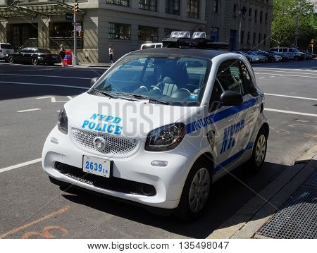 NEW YORK - JUNE 22, 2016: NYPD smallest car Smart ForTwo in Lower Manhattan.