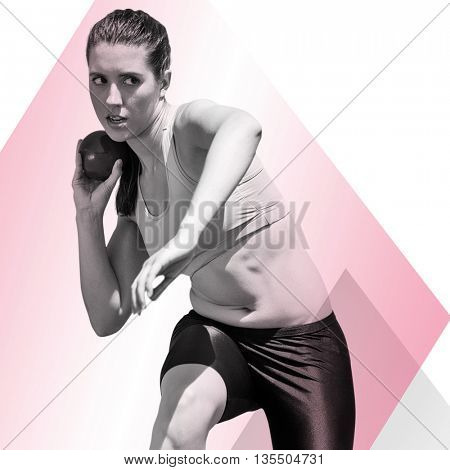 Sportswoman practising the shot put against different colors