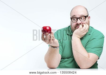 Complete A Man Looks At A Ripe Apple..