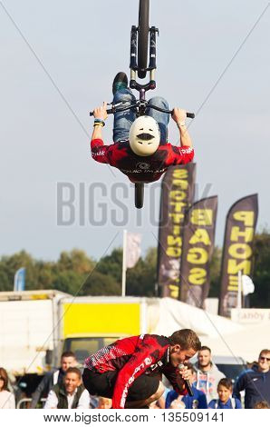 NEWBURY, UK - SEPTEMBER 21: A freestyle BMX team rider completes a full 360deg somersault for the watching public as part of the entertainment show at the Berks show on September 21, 2014 in Newbury