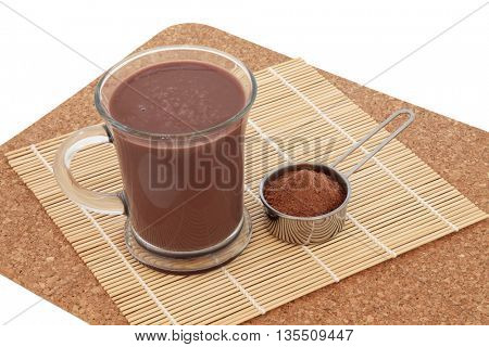 Chocolate maca health drink and supplement powder in a metal scoop. Used as an aphrodisiac and also by body builders and in weight training.