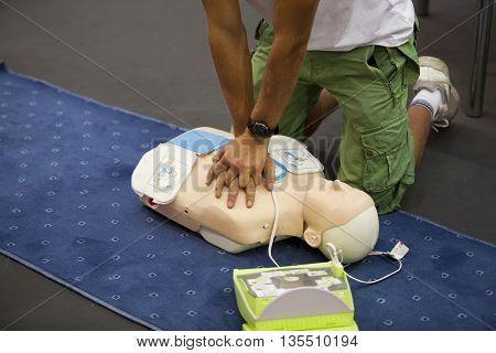 First aid training. Cardiac massage. Cardiopulmonary resuscitation - CPR training.