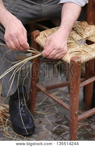 Mender Of Chairs While Repairing Old Wooden Chair