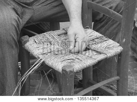 Mender Of Chairs While Repairing An Old Wooden Chair