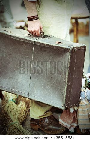 Migrant With Leather Suitcase Waiting To Boarding