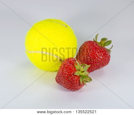 Wimbledon - A green tennis ball with 2 strawberries