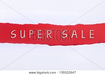 Torn paper with a SUPER SALE word on red background.
