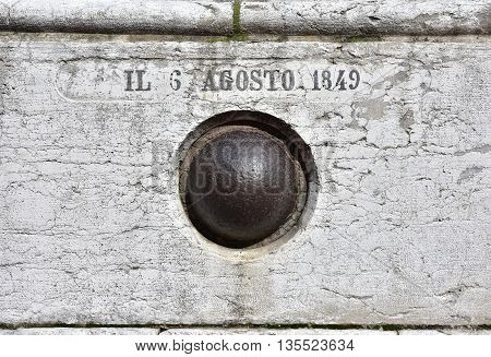 A cannonball embedded in the St Salvador (Holy Savior) facade in Venice from a 1849 bombardment by Austrian Army against Venice Republic