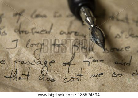 Old paper with handwriting and quill pen