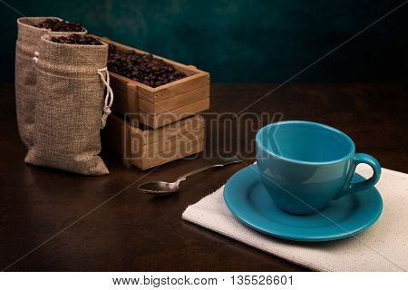 Empty Cup Of Coffee And Jute Bags