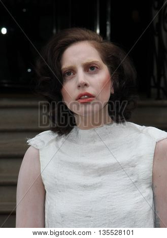 LONDON, UK -  01, 2013: Lady Gaga seen leaving her hotel where she was staying while her concerts where taking place in London this picture was taken from the street