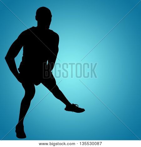 Front view of sportsman is stretching his muscles against blue vignette background