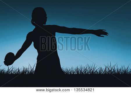 Concentrated sportswoman practicing discus throw against blue sky over grass