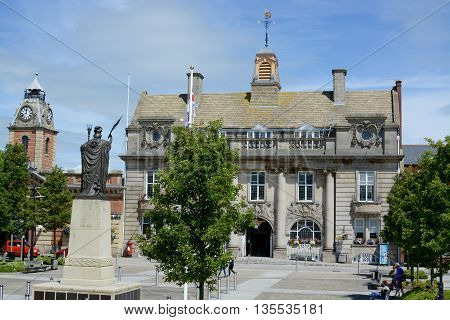 CREWE, UK - JUNE 23, 2016: Crewe town hall / municipal building and war memorial, Crewe, Cheshire, UK
