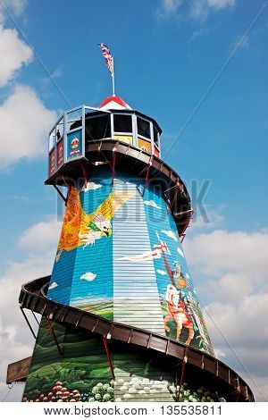 NEWBURY, UK - SEPTEMBER 21: A helter skelter ride stands proudly at the centre of the fun fair area at the Berks showground for the public to take pleasure rides on, on September 21, 2014 in Newbury