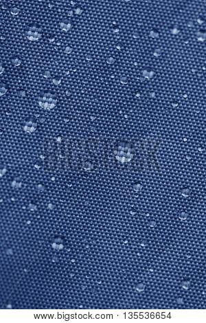 Blue rainproof tent sheet with rain drops