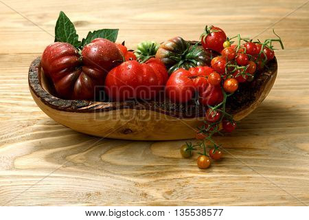 Fresh Heirloom Tomatoes On Wooden Table