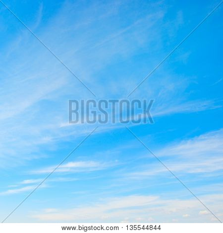 Light clouds in the blue sky. Heavenly background.