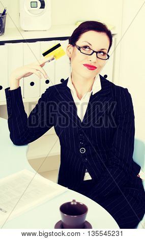Business woman with credit card.