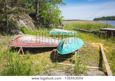Small Rowboats Lay Upside Down On The Coast
