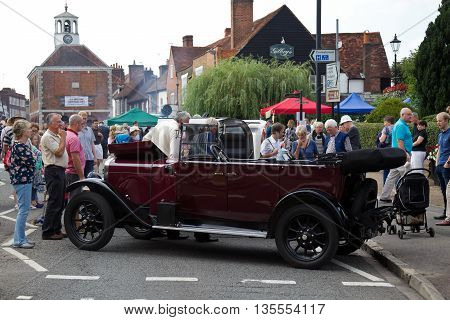 AMERSHAM, UK - SEPTEMBER 7: A vintage motorcar is parked on the High Street as a static display for the public to view as part of the Amersham Heritage day festival on September 7, 2014 in Amersham