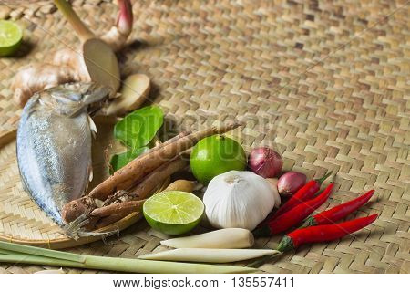 Ingredient of Tom Yum spicy soup With steamed mackerel Fish Traditional Thai food cuisine on wicker basketry texture