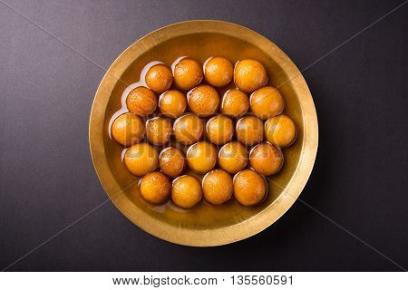Gulab jamun, or gulaab jamun, is a milk-solids-based sweet mithai