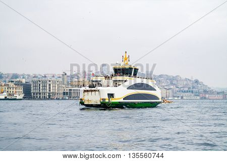 Istanbul ferry on Bosphorus Turkey. Passenger Ferry on Bosporus. Ship on Bosporus with Galata Tower on background. View from Istanbul.