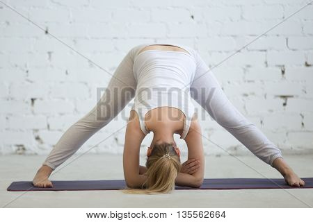 Pregnant Woman Working Out, Doing Yoga Pose