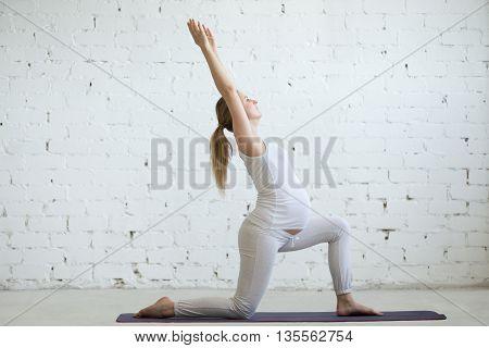 Pregnant Young Woman Doing Yoga Virabhadrasana 1 Pose