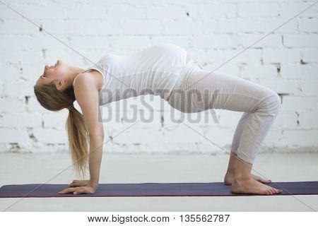 Pregnant Young Woman Doing Prenatal Yoga. Table Top Pose