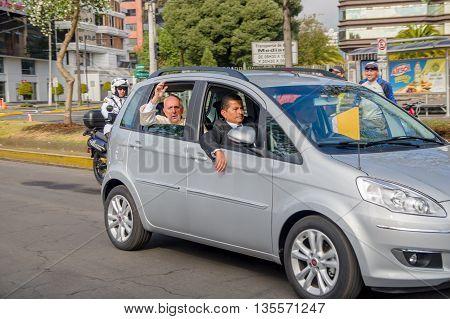 QUITO, ECUADOR - JULY 7, 2015: Grey little car transporting pope Francisco and his body guards, Ecuador visit.