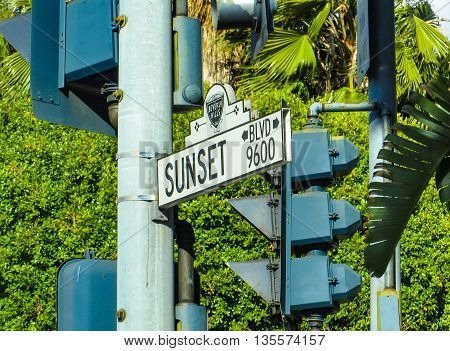 Sunset Boulevard, Beverly Hills - May 15, 2015: A signpost of the Sunset Boulevard road on traffic lights in California, America