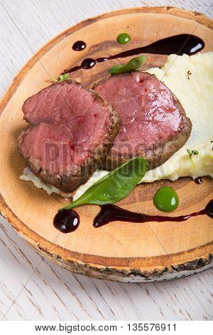 Prepared mignon steak served with mashed potato