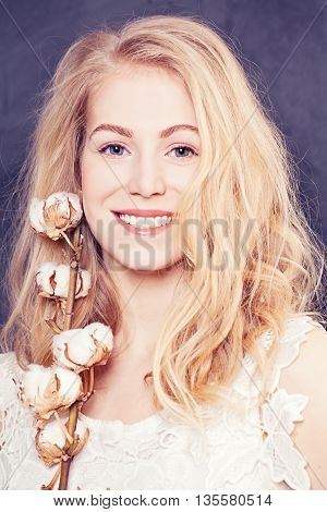 Beautiful smiling woman with healthy skin and hair
