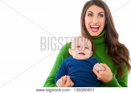 A photo of cheerful woman with baby boy. Happy mother and son are wearing casuals. They are spending leisure time isolated over white background.