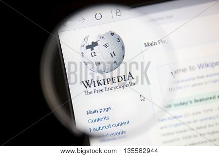 Ostersund, Sweden - June 23, 2016: Wikipedia website under a magnifying glass Wikipedia is a free Internet encyclopedia.