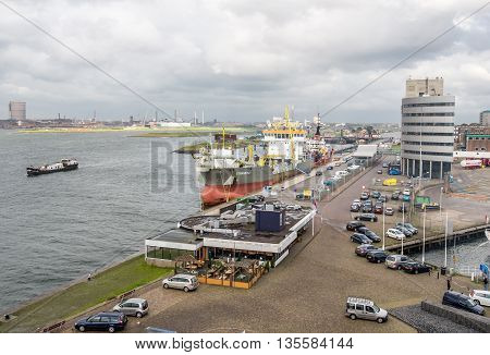 IJMUIDEN, NETHERLANDS - 15 SEPT. 2015: Hopper dredger in the harbor of IJmuiden. The port of IJmuiden is the largest fishing port of the country and is also the port of departure for many ferries