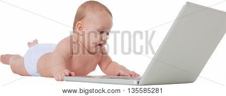 A photo of cute baby boy using laptop computer Full length of toddler is playing with wireless technology He is lying isolated over white background