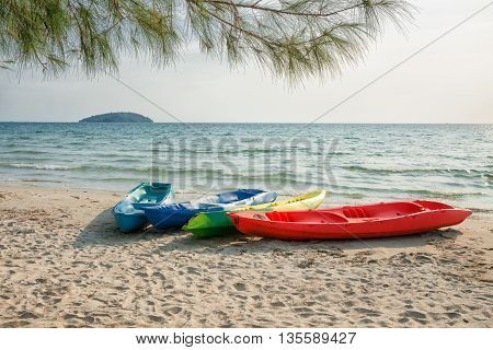 Four colorful plastic boat on a sandy beach. Sihanoukville Cambodia