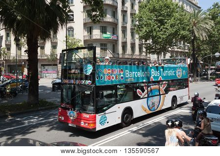 BARCELONA SPAIN - JULY 12 2013: Bus Touristic one of the most popular among tourists on the streets of Barcelona