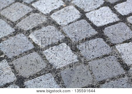 Grey bouldering with granite cobblestones as background or texture.