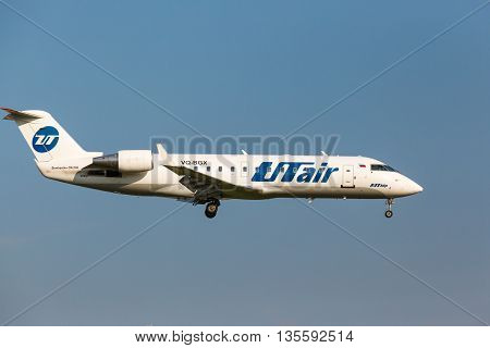VNUKOVO, MOSCOW REGION, RUSSIA - 28 August, 2013: Airplanes at Vnukovo international airport. Utair Airlines bombardier crj200 landing to runway