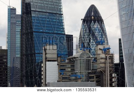 CITY OF LONDON, ENGLAND, 8 AUGUST 2015. Editorial Photograph taken from Top of Monument Tower, erected in memory of the Great Fire of London, showing modern sky scrapers including The Cheesegrater (The Leadenhall Building), The Lloyd's Building, The Gherk