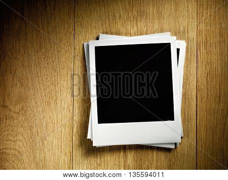 KYIV, UKRAINE - FEB 13, 2014: Polaroid photo cards on wooden background.