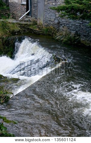 A small mountain stream with a strong current